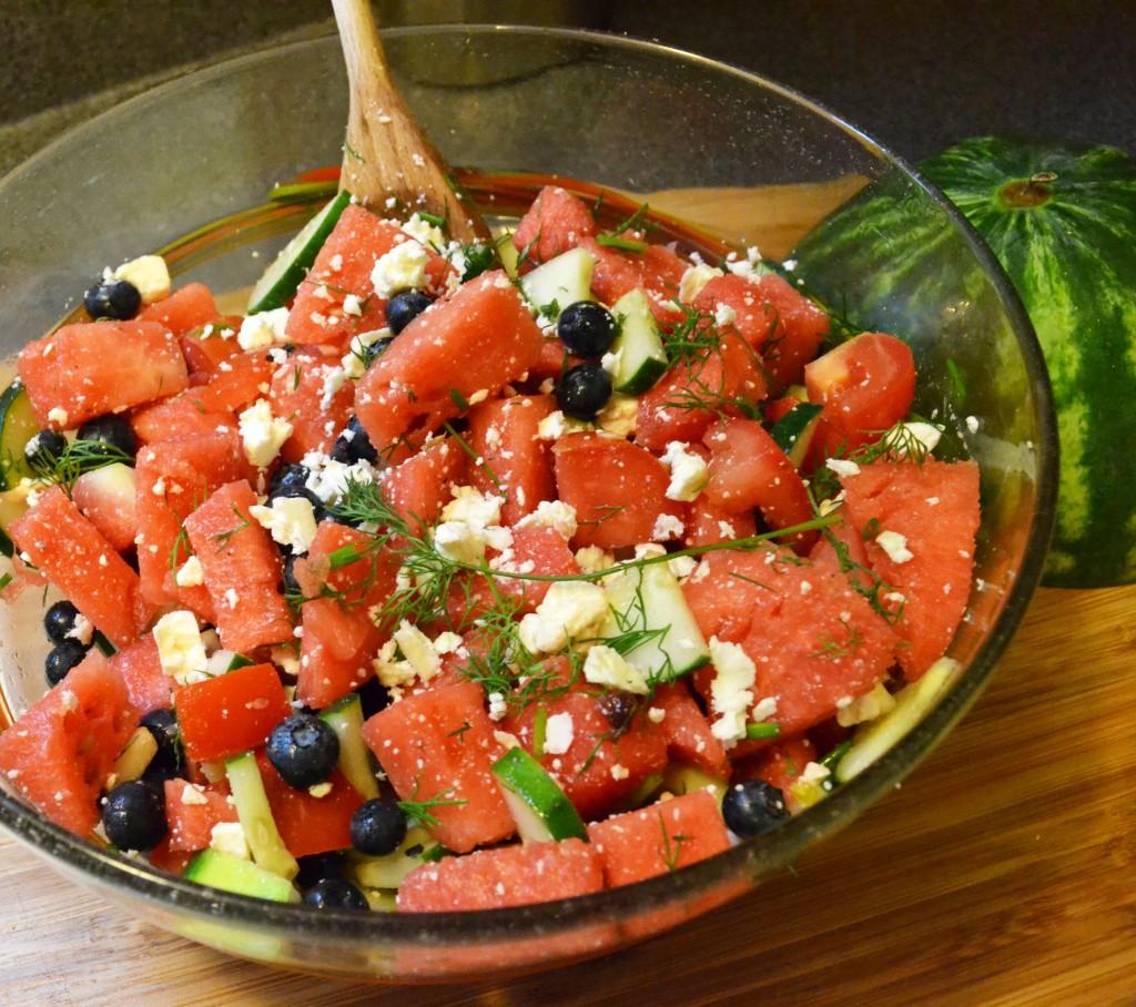 Place watermelon into a large salad bowl. Set aside. Chop cucumber ...