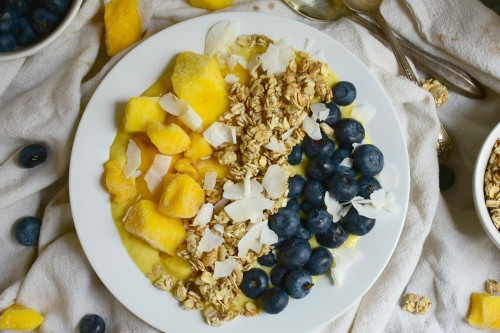 creamy smoothie bowl with mango