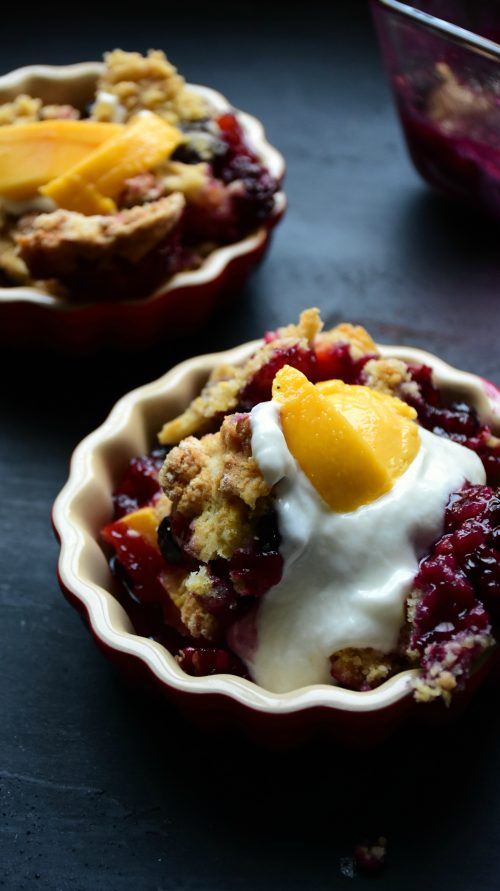 creamy mixed berry mango cobbler